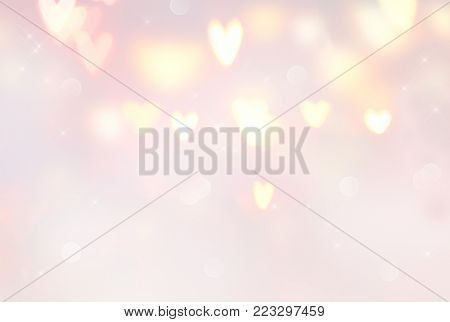 Holiday Valentine Hearts abstract glowing blurred background, bokeh. Defocused blinking heart shaped lights. St.Valentine's Day Wallpaper. Heart Holiday Backdrop, pastel colors, pink and beige