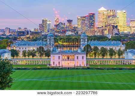 LONDON, UNITED KINGDOM - OCTOBER 07: This is a night view of Greenwich park which is a popular travel destination where people can see the Canary Wharf skyline on October 07, 2017 in London