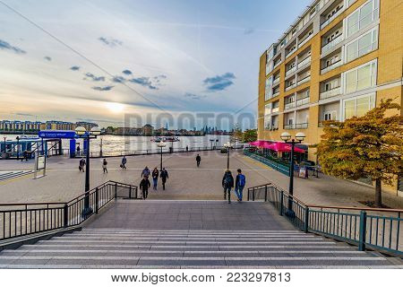 LONDON, UNITED KINGDOM - OCTOBER 07: This is the riverside area of Canary Wharf where people come to walk and take the bus boat to the other side of the river on October 07, 2017 in London