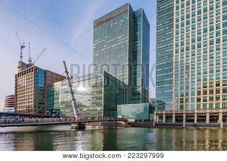 LONDON, UNITED KINGDOM - OCTOBER 07: Skyscrapers office buildings with pedestrian bridge in Canary Wharf financial district on October 07, 2017 in London