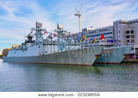 LONDON, UNITED KINGDOM - OCTOBER 07: Two Chinese battleships, Huanggang and Yangzhou docked in the Canary Wharf financial district area on October 07, 2017 in London