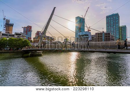 LONDON, UNITED KINGDOM - OCTOBER 07: Pedestrian bridge in Canary Wharf with skyscraper office buildings in the background on October 07, 2017 in London