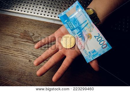 Business man holding bitcoin in his hand. Electronic money concept.