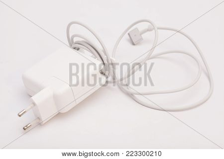 Electrical adapter to USB port on a white background