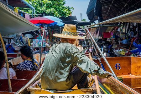 RATCHABURI, THAILAND - AUGUST 14: This is crowded boat scene in Damnoen Saduak which is a very popular and busy floating market on August 14, 2017 in Ratchaburi