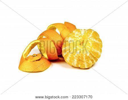 The peeled orange and orange peel on white background
