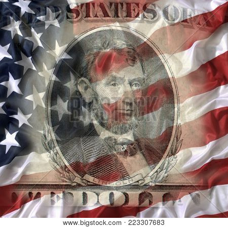 FIVE DOLLAR BILL WITH AMERICAN NATIONAL FLAG IN BACKGROUND