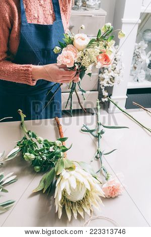 Floristry courses. Learn to master the art of ikebana. Florist shares her skills showing how to arrange flowers in a perfect beautiful bouquet