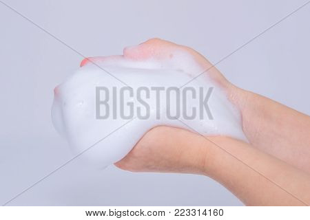 Foam Of Soap Or Shampoo On Female Hands