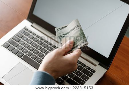 Unreported employment. Man getting his salary online. Illegal work, off the books job. No benefits package