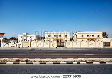 Road from Dubai to Sharjah with typical architecture, United Arab Emirates.