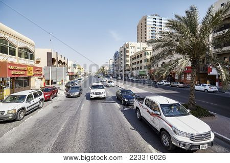 Sharjah, United Arab Emirates - May 03, 2017: Busy street in downtown Sharjah. The city is the third largest and third most populous one in the UAE.