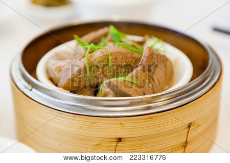 Braised pork liver dim sum in bamboo steamer is a popular dish in Cantonese restaurants in Hong Kong.