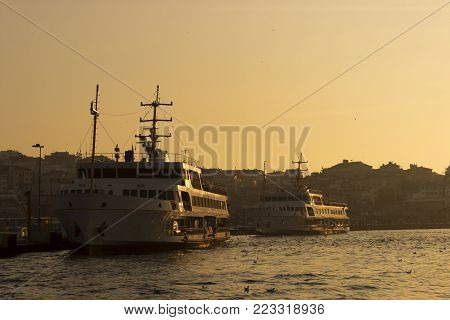 Ferries On The Port With Istanbul Sunset