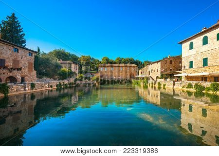 Bagno Vignoni village medieval thermal baths or hot pool. Tuscany, Italy, Europe