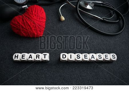 Word Heart Diseases From White Cubes With Letters On Dark Background With Red Thread Heart And Tonom