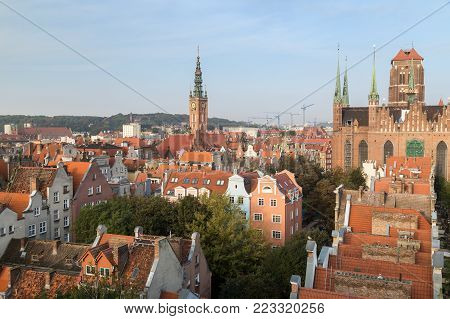 Old residential buildings, Main Town Hall's tower and St. Mary's Church at the Main Town (Old Town) in Gdansk, Poland, viewed from above in the morning.
