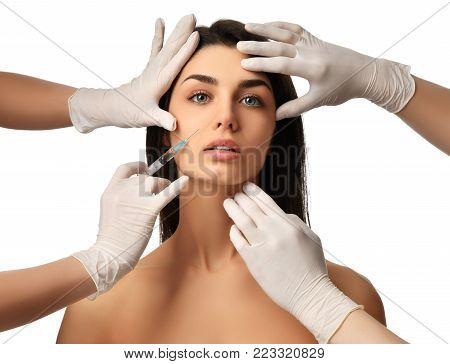 Face cosmetology plastic surgery beauty concept young brunette woman receiving Hyaluronic Acid injection in glove with syringe poster