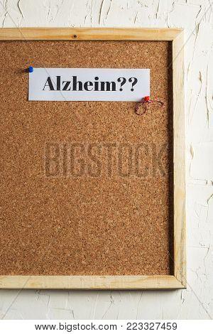 Alzheimer Text on Cork Board, White Wall