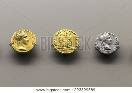 Merida, Spain - December 20th, 2017: Golden and silver roman coins of Augustus Emperor at  National Museum of Roman Art in Merida, Spain