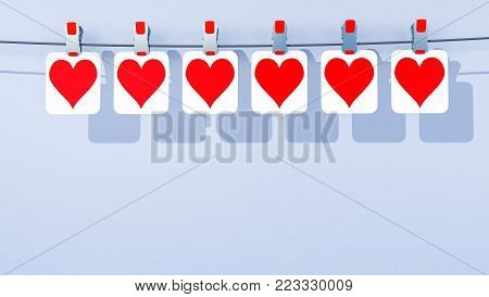 A 3D illustration of a row of paper Valentine's Day hearts hanging by clips from a wire, or line, viewed from a center camera location