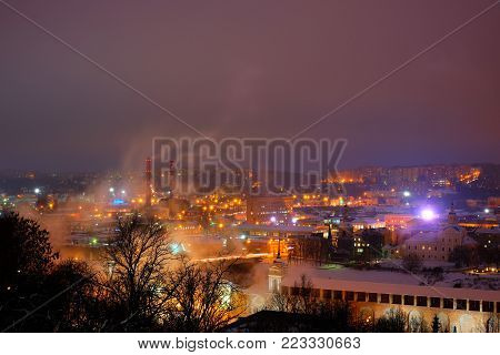 Beautiful views of evening Smolensk in the winter. Evening Smolensk in winter - snow covered snow blanket the earth, see the bright lights of the evening city. far - wall, visible Church