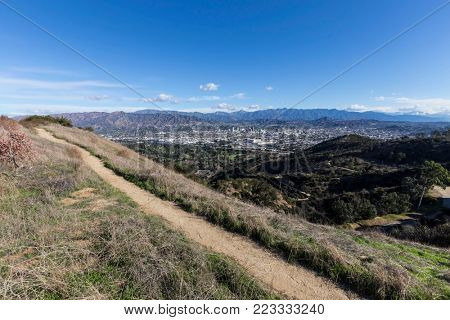 Griffith Park city view hiking path in Los Angeles, California.  Clear winter morning view towards the San Gabriel mountains and downtown Glendale.