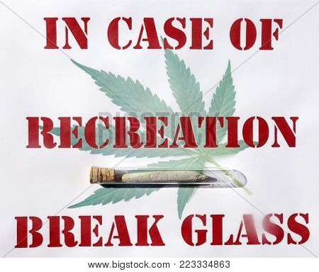 Sign with Marijuana Cigarette aka JOINT in a glass test tube reads IN CASE OF RECREATION BREAK GLASS. Marijuana is now legal in California for recreational use.