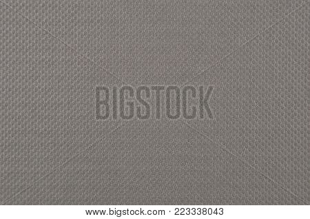 Embossed paper background, grey color, close up
