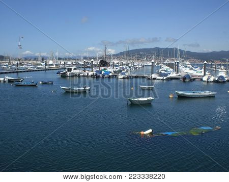 View of Baiona beach and boats in northern Spain