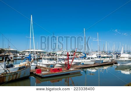 MOSS LANDING, CALIFORNIA - SEPTEMBER 9, 2015 - Boats docked in the Moss Landing Harbor. Moss Landing is located on the shore of Monterey Bay on the California coast.