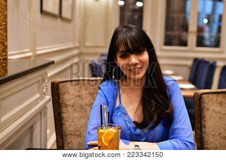 Restaurant Concept. Asian women eating in restaurant. Asian women are happy to eat. Asian women relax in a restaurant. In the restaurant, Asian women are smiling happily.