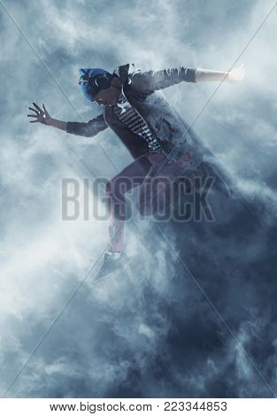 Young man break dancing on smoke background