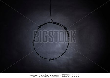 old rusty circle barbwire on gray background