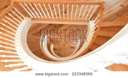 White and Golden Brown Wooden Spiral Staircase