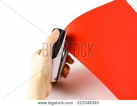 Fasten The Red Paper With Staples On A White Background. Closeup