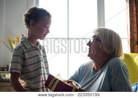 Grandson giving a gift to his grandma