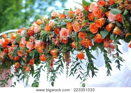 Flower Wedding Bouquets or Garland for wedding Arc, including Orange Roses and Chrysanthemums