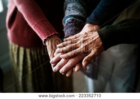 Closeup of hands of group of seniors