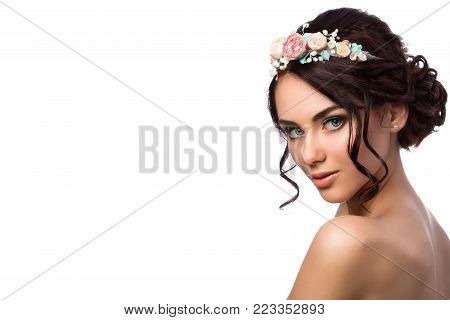 Portrait of young beautiful bride over white background. Wedding coiffure and make-up. Studio shot. Copy space. poster