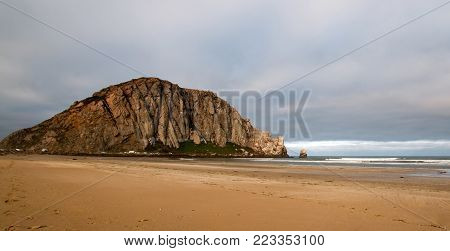 Morro Rock at sunrise at Morro Bay State Park beach on the  Central California Coast USA