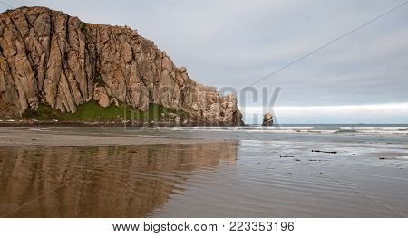 Morro Rock At Sunrise at Morro Bay State Park popular vacation / camping spot on the Central California Coast U S A