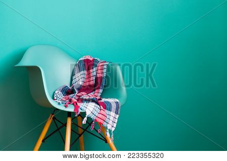 Blue color chair, modern chair designer. Plastic chair. Plaid. Arcadia