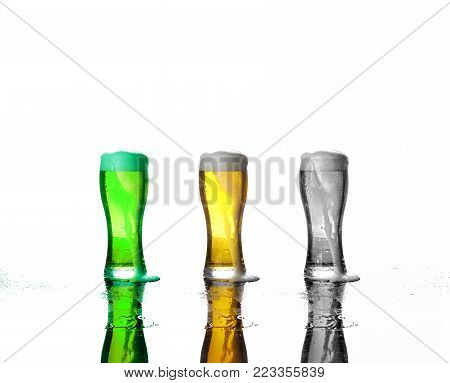 Concept: Various beer festivals. St. Patrick's Day, Oktoberfest, Black Friday.Three glasses of beer: green beer, beer lager, a black and white image of beer with foam on a white background.