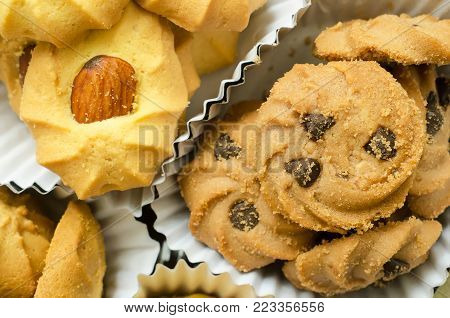 Variety of different kinds of sweet cookies with chocolate chip , almond cookies