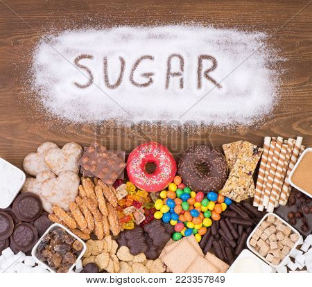 Food containing sugar, top view. Too much sugar in diet causes obesity and diabetes.