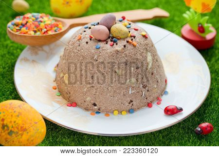 Chocolate curd easter with colorful sprinkling, traditional russian orthodox easter quark cheese dessert