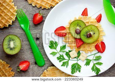 Owl waffle - funny healthy breakfast dessert snack idea for kids, sweet dutch waffles with strawberry and kiwi shaped cute owl