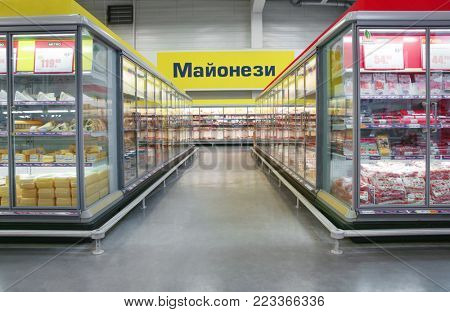 MYKOLAIV, UKRAINE - October 31, 2017: Cooling shelves with dairy and sausage products in hypermarket METRO