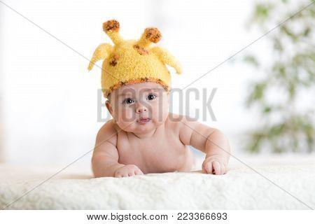 funny pensive baby kid in giraffe costume